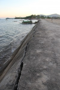 The crack on the sea wall is the only sign that Typhoon Yolanda caused the waters to rise in Barangay Mangorocoro, as it protected the villagers from the wrath of the typhoon
