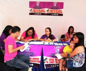Social workers from DSWD attend to queries of a prospective adoptive couple.