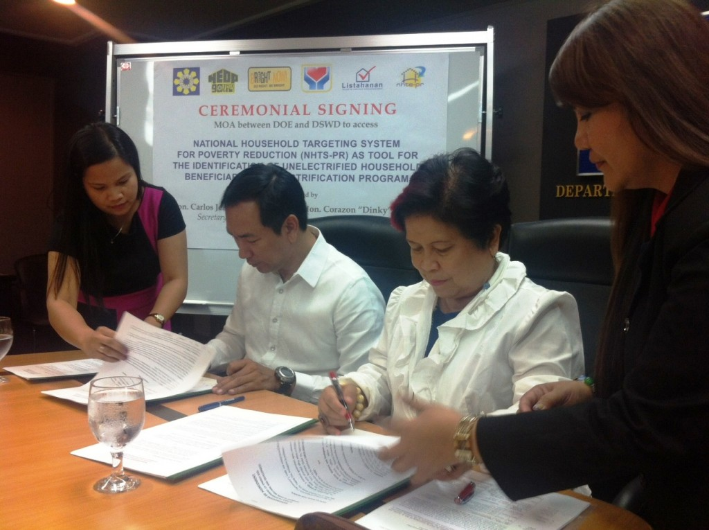 DSWD Secretary Corazon Juliano-Soliman and DOE Secretary Carlos Jericho L. Petilla sign a memorandum of agreement on the implementation of the Nationwide Intensification of Household Electrification (NIHE) project.  As a partner agency, the DSWD shall provide a list of potential household beneficiaries for the NIHE project using the Listahanan or the National Household Targeting System for Poverty Reduction (NHTS-PR).