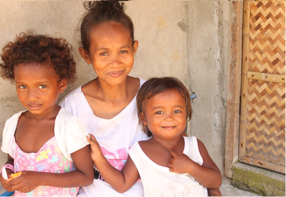 Leonida, with her two young kids, is thankful for the help and attention her family is getting from the government.