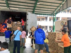 DSWD family food packs are being unloaded at H. Bautista Elementary School Evacuation Center, Marikina City for distribution to the evacuees. The relief aid arrived in the city yesterday.