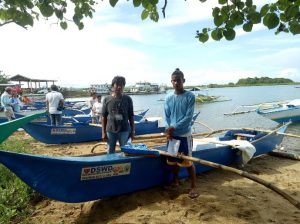 Dumagat fishermen pose with their new fiberglass boats provided by the DSWD through its Sustainable Livelihood Program.